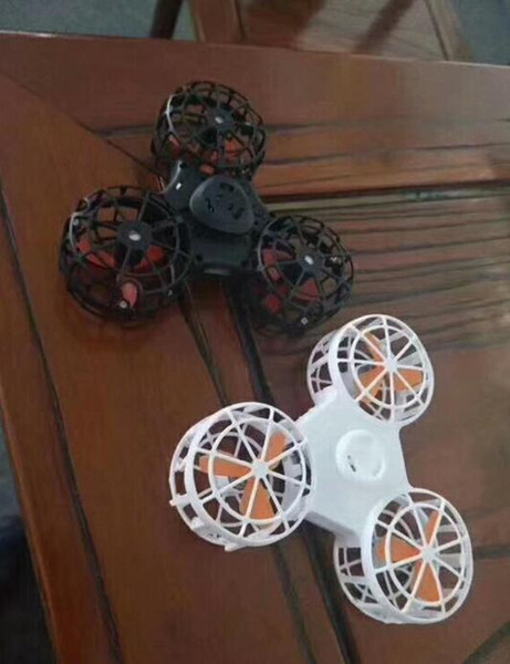 best selling The new three-motor rechargeable flying gyro double interactive game gyro aerial rotation fingertip gyro TL 001