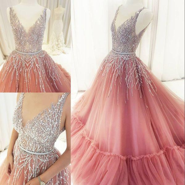 Sparkly Lentejuelas vestido de bola vestido de fiesta V-cuello sin mangas moldeado sin mangas vestido de noche Dubai Vestido de fiesta magnífico vestido de fiesta una línea de tul acanalado