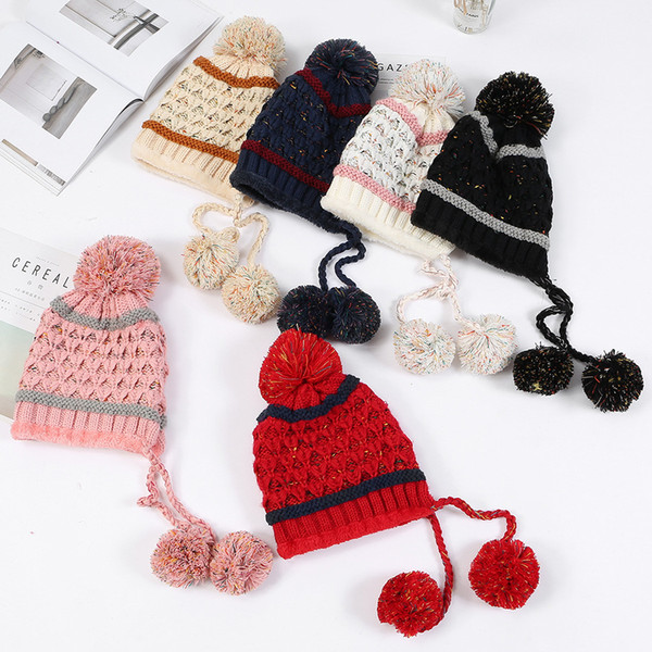 Autumn and winter new color matching pineapple flower three hair ball wool hat ladies wild plus velvet knitting