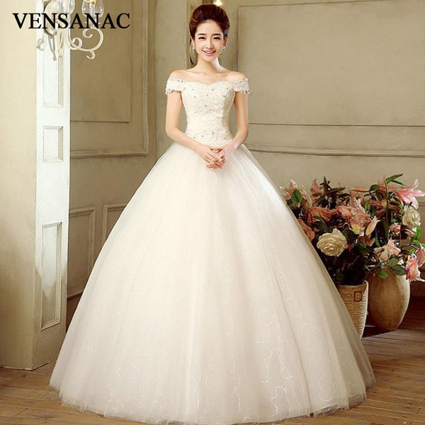wholesale 2018 Crystal Boat Neck Sequined Ball Gown Wedding Dresses Lace Appliques Short Sleeve Tulle Bridal Gowns