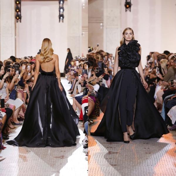 Elie Saab 2019 Vestidos de baile con cuello halter Mono negro con volantes escalonados Vestidos de noche con cuentas Tren de barrido de gasa Vestidos de fiesta formales
