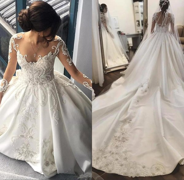 2018 Sheer Long Sleeves Satin A Line Wedding Dresses Tulle Lace Applique Beaded Chapel Train Wedding Bridal Gowns With Buttons Back BA8164