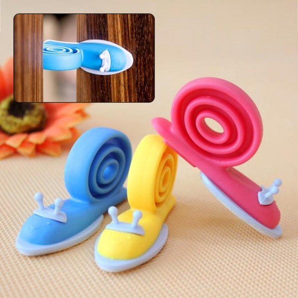 top popular free shipping hot sale Soft Plastic Baby Home Safety Door Stopper Protector Children Safe Snail Shape Door Stops Baby gate corner protector 2019