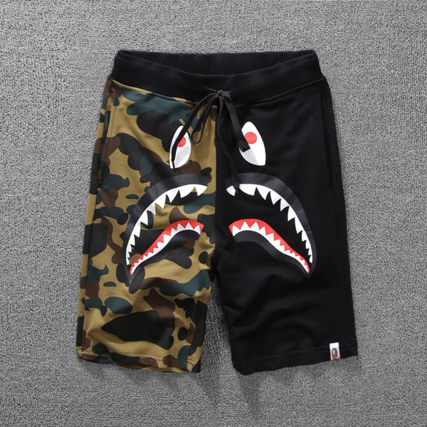 New style men's clothing, color shark mouth printing, stitching and casual pants, pair of men and women's shorts five points trousers