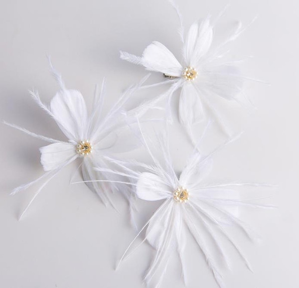 Bridal headwear, hand ornament, white feather, hairpin, wedding gown, wedding dress and accessories.
