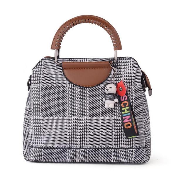 Sonbahar Yeni PU moda bayanlar sert banliyö çanta 2018 yumuşak yüz yeni kafes çanta ücretsiz kargo