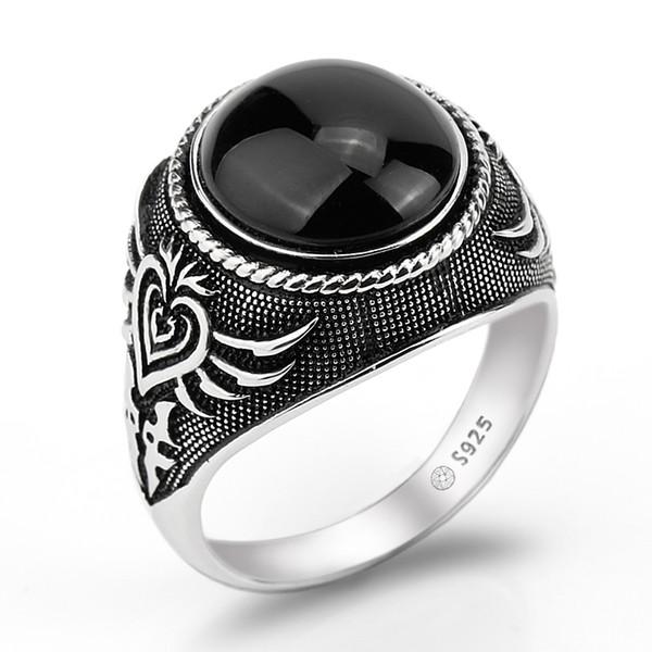 bague en argent avec pierre noire