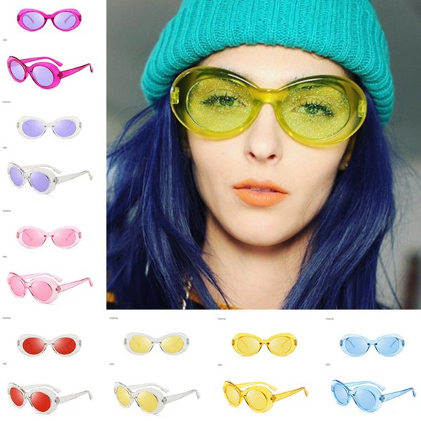 The new best selling European and American fashion trend oval flash male and female sunglasses lens T6C034