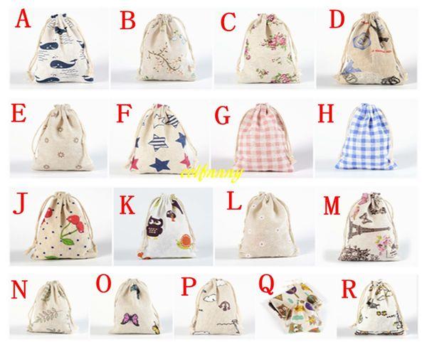 50pcs / lot liberano il trasporto 10 * 14cm sacchetto del regalo dei monili di cerimonia nuziale cotone stampato borsa con coulisse shopping bags piccolo sacchetto per i bambini