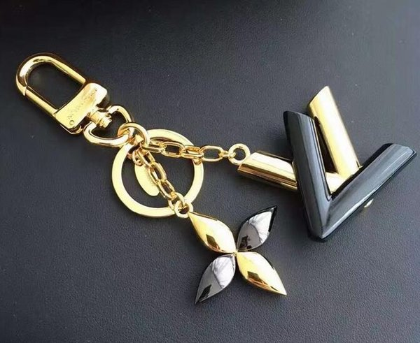M68009 gold / black top package FACETTES BAG CHARM KEY HOLDER TAPAGE CHARM KEY HOLDERS