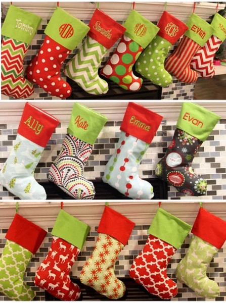 top popular Brand New 18 Designs Christmas Stocking Embroidered Personalized Stocking Gift Bag Xmas Tree Candy Ornament Family Holiday Stocking 2019