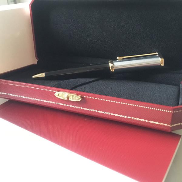 un stylo et une boîte en or noir