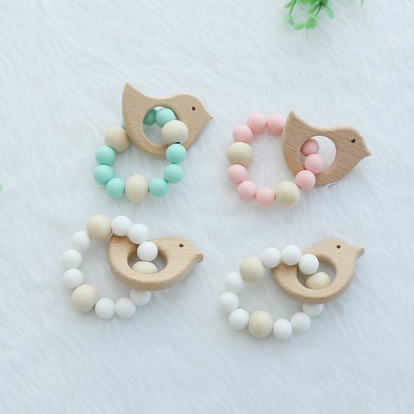 top popular Wooden Baby Bracelet Animal Shaped Jewelry Teething For Baby Organic Wood Silicone Beads Baby Rattle Stroller Accessories Toys 2019