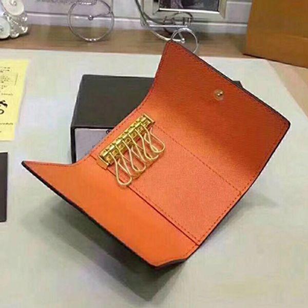flor marrón naranja dentro