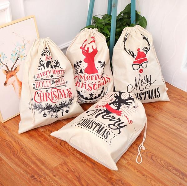 Sacchi di Babbo Natale Borsa con cordoncino Sacchetti regalo di Natale vintage Decorazioni natalizie Alce Merry Christmas 2019 Capodanno 4 Disegni 5pcs YW1579