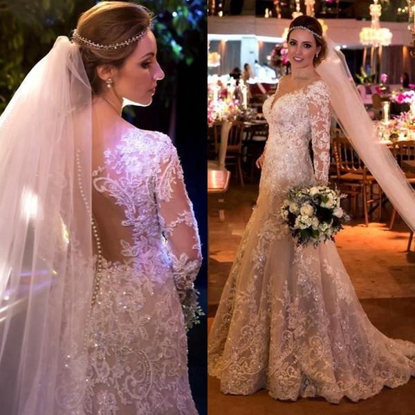 Arabia Dubai Perlas de perlas Vestidos de novia Brillantes apliques de encaje de cristal Vestidos de boda de manga larga 2018 Vestido de novia con cuello en V vintage Sirena