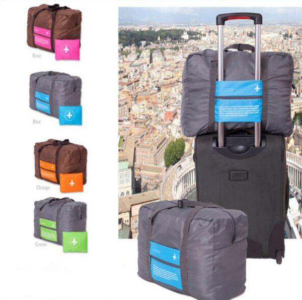 Bolsas de viaje de nylon a prueba de agua mujeres hombres de gran capacidad bolsa de lona plegable organizador de embalaje cubos equipaje