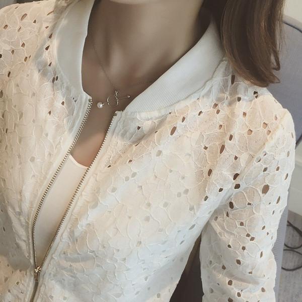Корейская версия на молнии с тонкими полыми кружевами Куртка с длинными рукавами Тонкая белая сыпь Женская короткая куртка на молнии Пальто