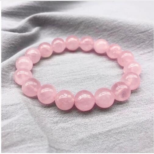 Commercio all'ingrosso rosa polvere di cristallo di quarzo naturale pietra streche braccialetto elastico cord pulserase gioielli perline amanti regalo donna