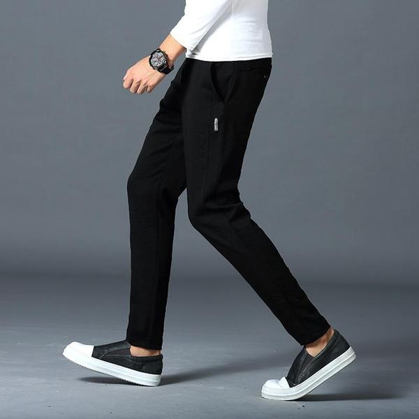 Homens preto cinza Pure color stretch Calças pés pequenos streetwear movimento moda lazer tendência turismo ao ar livre O novo estilo