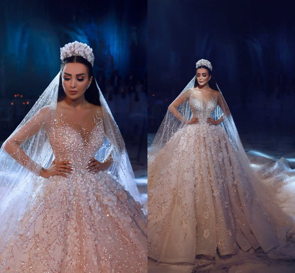 2019 Luxury Sheer Neck Crystals Beaded Lace A Line Wedding Dresses Illusion Long Sleeves Pearls Appliqued Bridal Gowns Arabic robe de mariée