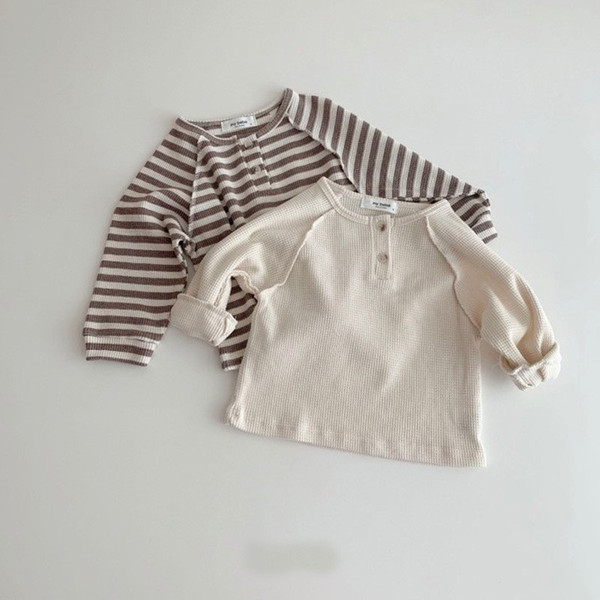 top popular INS Autumn Newest Desings Kids Girls Sweaters Pullover Front Buttons Soft Knitted Stripes Tees Children Girls Sweater Outwears 2021