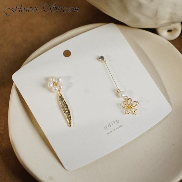 Aiguille en argent avec perle naturelle ajourée ajourée de fleurs ajourées asymétriques