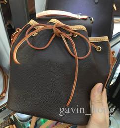 Nice Style Free Shipping Fashion Leather Bucket Bags for Women Small Mini Cutout Women Messenger Bag Drawstring M41346