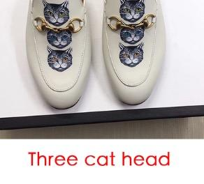 Kopf mit drei Katzen