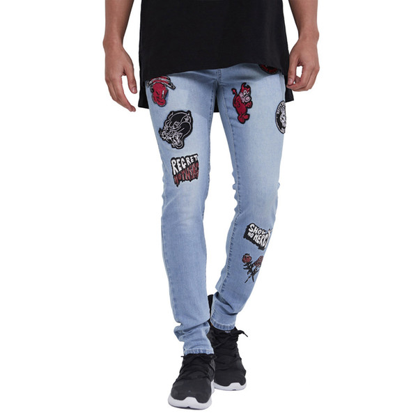 DOMBBFY Brand men hip hop jeans skinny Jogger Cartoon embroidery fashion men's Denim Pants locomotive bike Sweatpants trousers