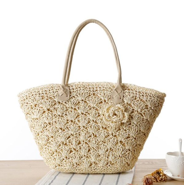 Fábrica al por mayor bolso de la manera de las mujeres tejidas de paja bolsa de paja delicado encaje de ganchillo playa bolsa de verano nuevo bolso de ganchillo estéreo