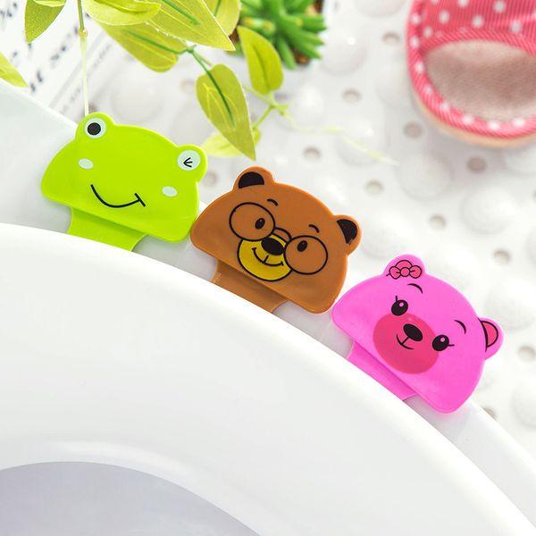 Cartoon Toilet Seat Cover Dispositivo di sollevamento Bagno Wc Coperchio maniglia Sticker portatile Maniglia sanitaria Accessori sedile bagno