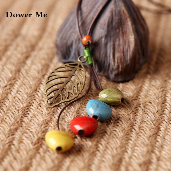 Großhandel-Dower Me Keramikperlen Anweisung Halskette Frauen Retro ethnischen Pullover Collier Femme Gold verlässt Anhänger Halskette Anime Koly