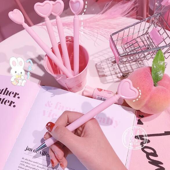 Creative heart-shaped pen girl pink love gel pen student office stationery black pen photo props cartoon