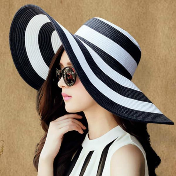 XUYIJUN Verano Mujer Sun Panamá Sombrero Nuevo Patrón Clásico Negro Y Raya A lo Largo de la Playa Paja Protector Solar Sombrero de Sol al por mayor
