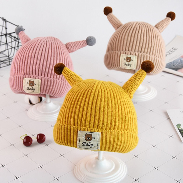 Autumn and winter baby warm hat Korean version of the child bear thickening earmuffs wool hat baby cartoon horn knit hat