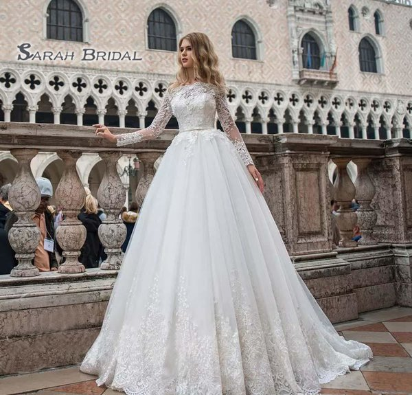 top popular 2019 Vintage Tulle Bride Dress Off Shoulder Sexy Lace Appliques Long Sleeves Ball Gown Evening Wear Formal Gown High-end Wedding Boutique 2020