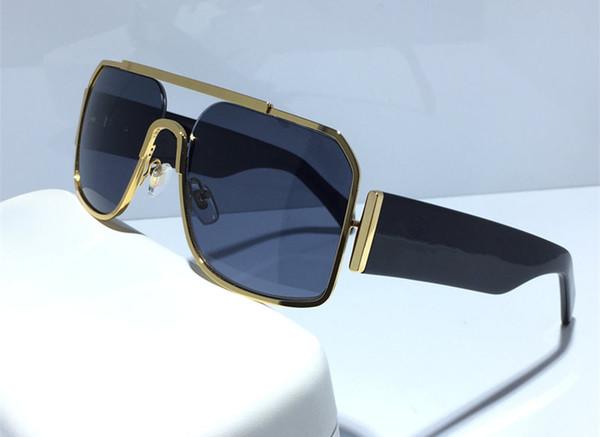 altın çerçeve siyah lens