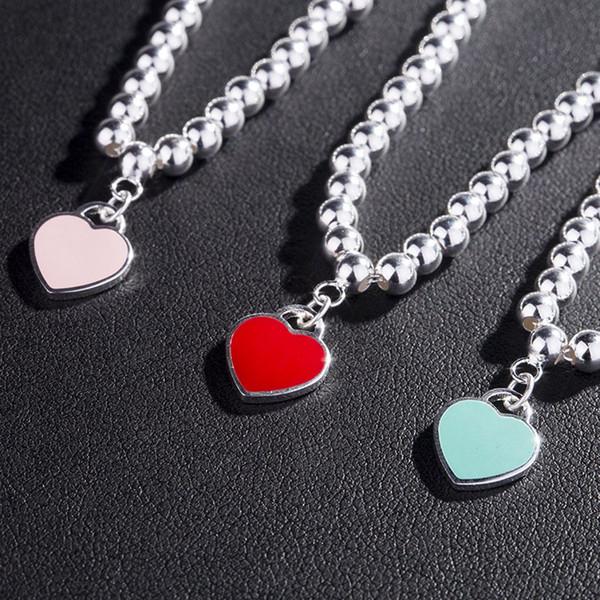 Las pulseras de plata pulseras de los brazaletes para muchachas de las mujeres del corazón rojo encantador de la venta caliente en forma de corazón de color rosa pulseras azules