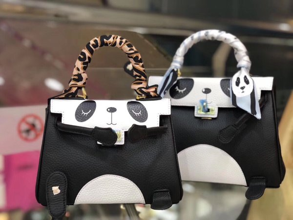 black and white splice color lovely sweet style genuine leather top material with panda print two size lady shoulder bags cross body bags