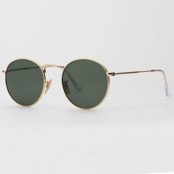 Golden frame green lens