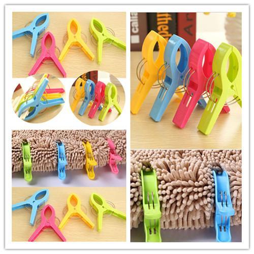 4pcs pinces à linge en plastique suspendus clip crochets épingles à linge pince coupe-vent pince clips en plastique multicolores