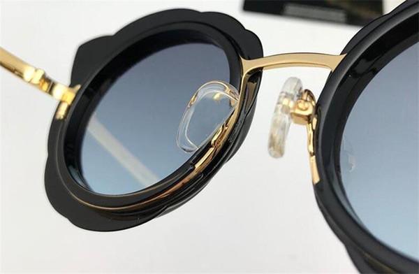 Al por mayor- gafas de sol de diseñador de moda 9528 marco de ojo de gato encantador estilo popular para mujeres que venden gafas de protección uv400 de alta calidad