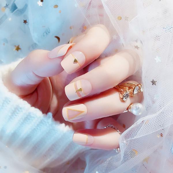 Femmes Mode Nude Rose Couleur Faux Ongles Filles Mignon 3D Rivet Faux Ongles Moyen-long Taille Couverture Complète Nail Art Conseils avec De La Colle