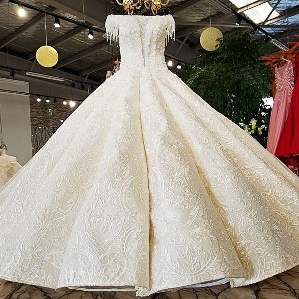 Gonna grande Abito da sposa Maniche corte Scollo a spalla 100% Immagine reale Visualizza originale abito da sposa di design all'ingrosso Cina online