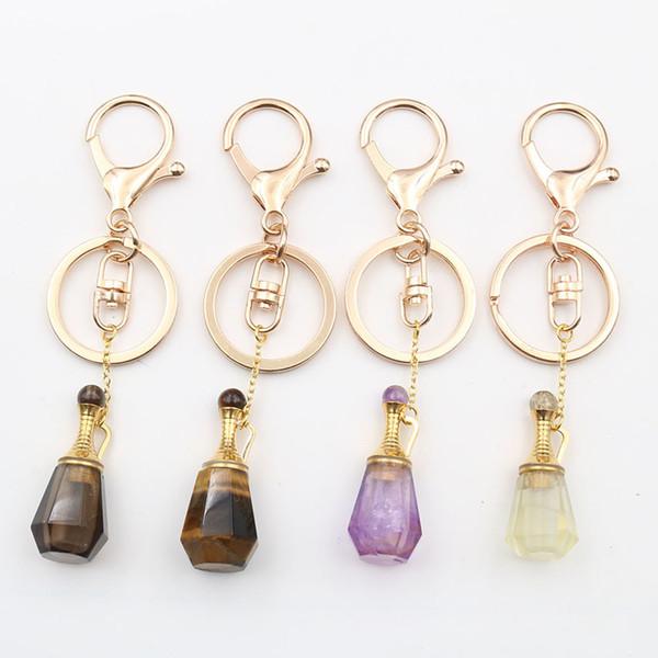 XSM Duft-Flasche Goldfarbe Schlüsselanhänger Kristallanhänger Parfümöl Diffusor Schlüsselanhänger Tasche Hanging-Auto-Schlüssel-Ring-Halter Schmuck