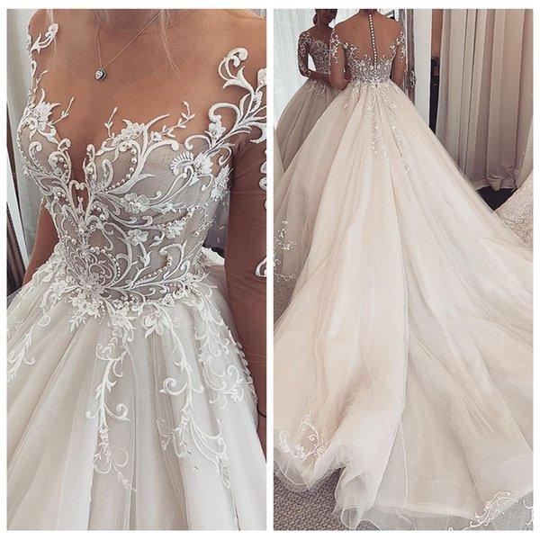 Sheer Mangas largas Apliques de encaje Una línea de vestidos de novia Perlas de cuentas 2019 Vestidos de novia largos modestos personalizados Hermosa túnica de matrimonio