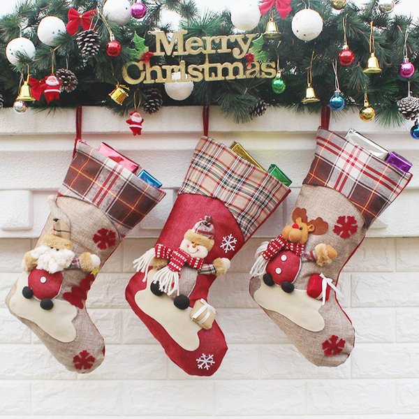 Calze Nuovo Natale regali della caramella del sacchetto del partito Decorazione di Natale del fumetto del pupazzo di neve di Santa bambola Calze Home Decor Camera HHA898