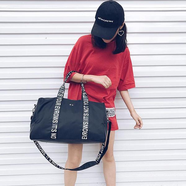 Diseñador de moda negro Bolsos de embrague Bolsos Mujeres Hombres Bolsos de viaje con cremallera Bolso de equipaje de gran capacidad con impresión de letras portátil