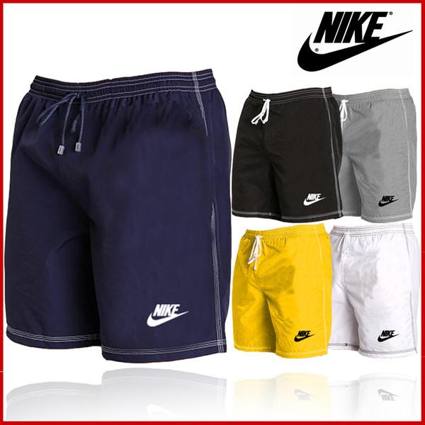 мужские футболки мужские шорты большого размера свободные спортивные брюки три минуты сухие пляжные брюки прямые трубки простые домашние брюки полосы